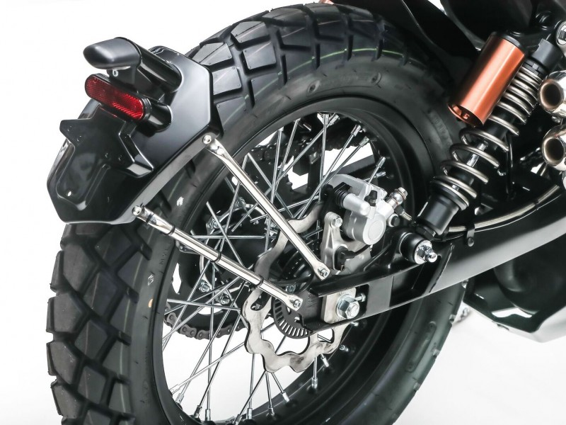 Twin rear shocks, ABS braking, box section swingarm, and wide section spoked rims